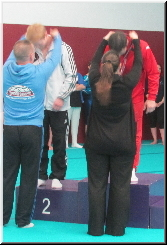 coach Stef - Elite Gymnastics Club, has won a Gold medal