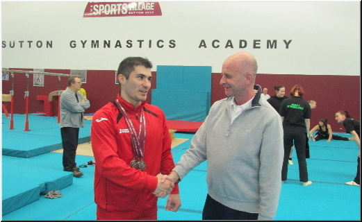 Stef with coach Maurice at Sutton Gymnastics Academy