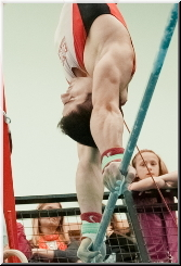 Stef on High Bar at Sutton gymnastics academy 2014