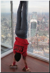 Stefan Kolimechkov performing gymnastics on the top of the highest building in London UK